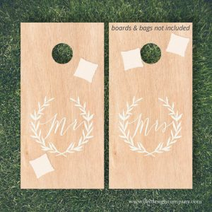 Cornhole board design with Mr and Mrs inside wreaths