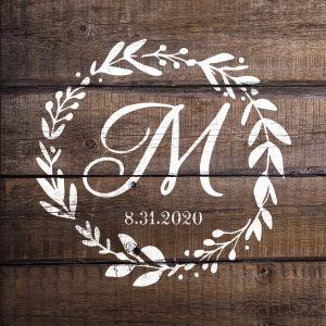 Floral wreath monogram vinyl design painted on a wood sign