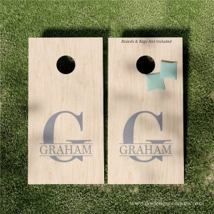 Cornhole boards with split monogram name vinyl design
