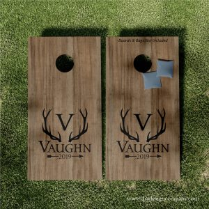 Cornhole boards with monogram inside antlers with last name below and established date in arrow