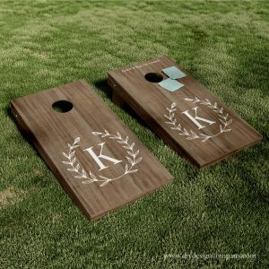 Cornhole boards with wreath and monogram vinyl decal or stencil