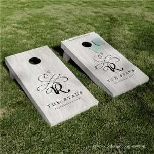 Cornhole boards with fancy momogram and family name
