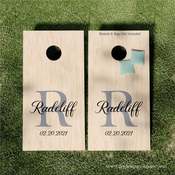 Cornhole boards with large initial and name and date.