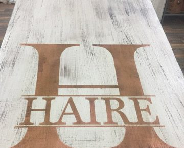 Customer photo split monogram on cornhole boards